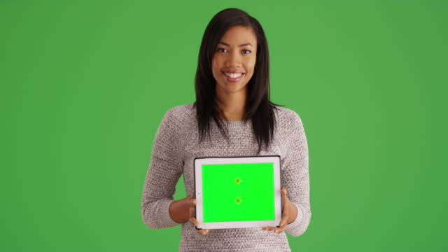 smiling black woman holding tablet with green screen for custom content - electronic organiser stock videos & royalty-free footage