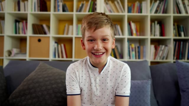 smiling boy have a video call at home - webcam stock videos & royalty-free footage