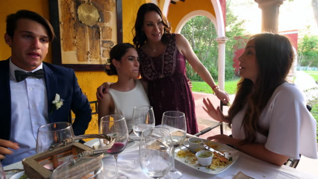 ms smiling bride and groom enjoying dinner with friends during outdoor wedding reception - wedding guest stock videos and b-roll footage