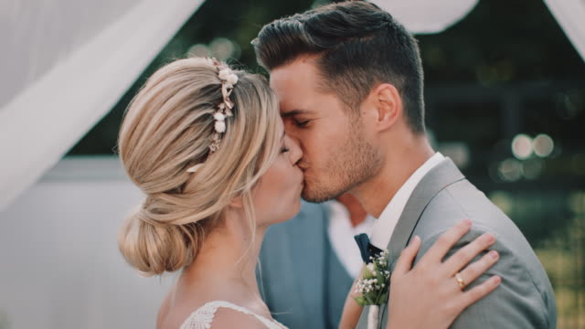 smiling bridegroom kissing bride at wedding - hairstyle stock videos & royalty-free footage