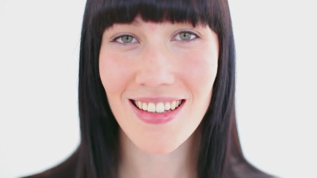 smiling brunette using a cotton pad - bangs stock videos & royalty-free footage