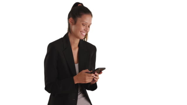 Smiling business woman text messaging on white background with copyspace
