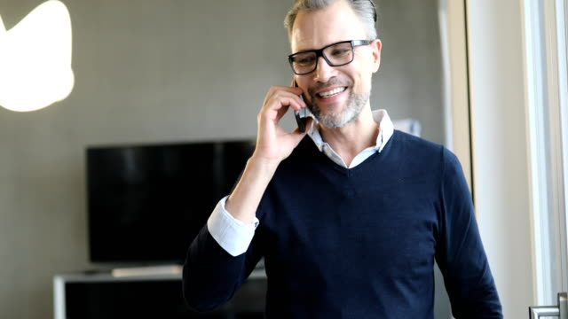 smiling businessman discussing on mobile phone - only men stock videos & royalty-free footage