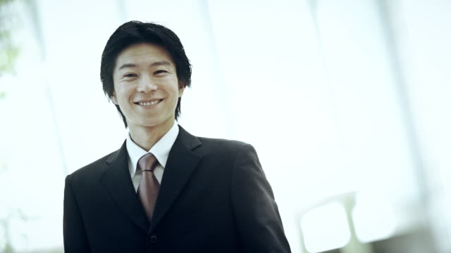smiling businessman - only japanese stock videos & royalty-free footage