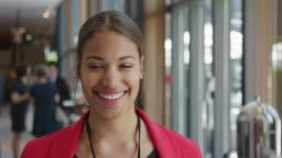 Smiling businesswoman against professionals