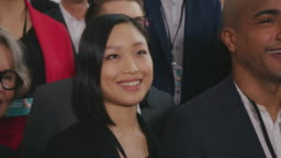 Smiling businesswoman looking away with colleagues