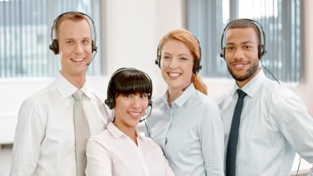 ds smiling call center team portrait - four people stock videos & royalty-free footage