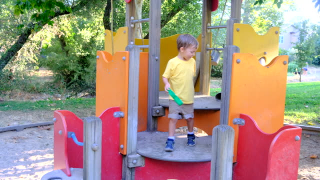 smiling child boy playing in the playground - smirking stock videos and b-roll footage