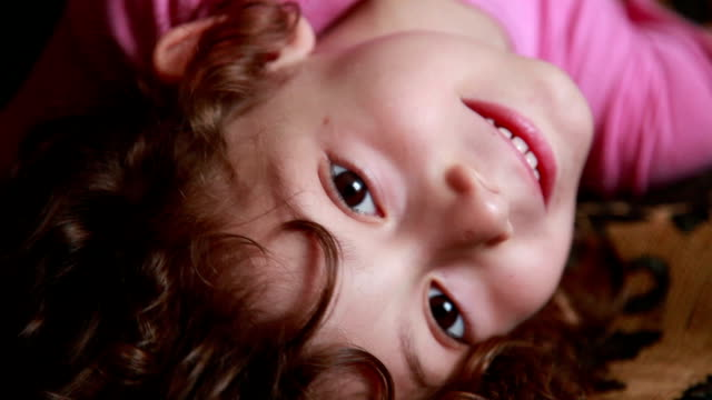 smiling child lying on the back - lying on back stock videos & royalty-free footage