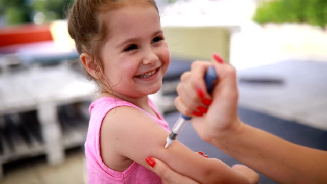 smiling child taking an insulin injection - syringe stock videos & royalty-free footage