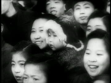 vidéos et rushes de smiling chinese women in crowd with children / china / educational - 1949