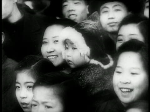 b/w 1949 smiling chinese women in crowd with children / china / educational - 1949 stock videos & royalty-free footage
