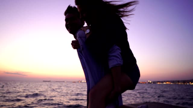 smiling couple having fun at sunset - handsome people stock videos & royalty-free footage