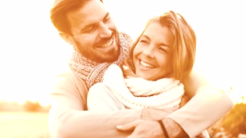 smiling couple hugging outdoors at sunny day - mid adult couple stock videos & royalty-free footage