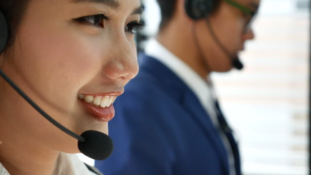 4k smiling customer support operators answering a call from customer - headset stock videos & royalty-free footage