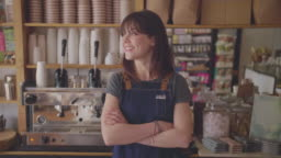 Smiling Deli Owner With Arms Crossed In Coffee Store