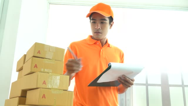 smiling delivery man hands over box, service man working in uniform - delivery person stock videos & royalty-free footage