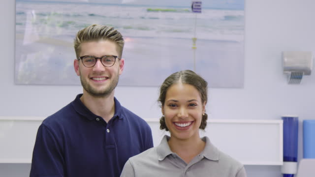 smiling dental coworkers in dentist's office - dentist's office stock videos and b-roll footage