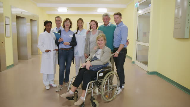smiling doctors with patients in hospital - rehabilitation center stock videos & royalty-free footage