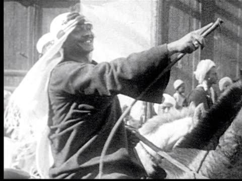 1925 b/w ms smiling egyptian sheik sitting on donkey / cairo, egypt - black and white stock videos & royalty-free footage