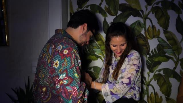 stockvideo's en b-roll-footage met ms r/f smiling embracing couple on date in night club - romantische activiteit