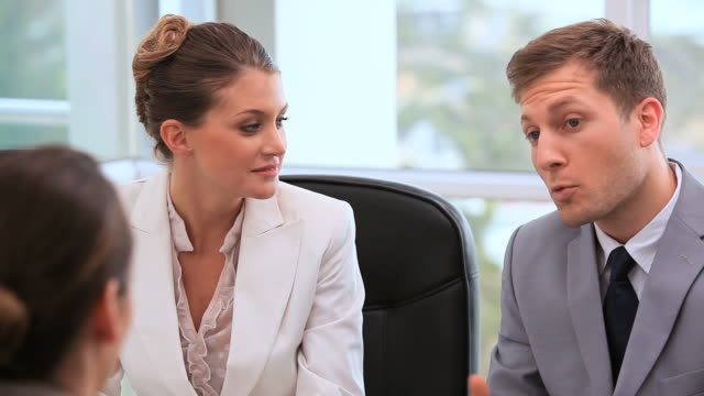 Smiling executives talking together