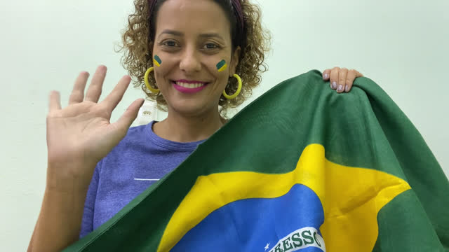 smiling fan waves the brazilian flag - national flag stock videos & royalty-free footage
