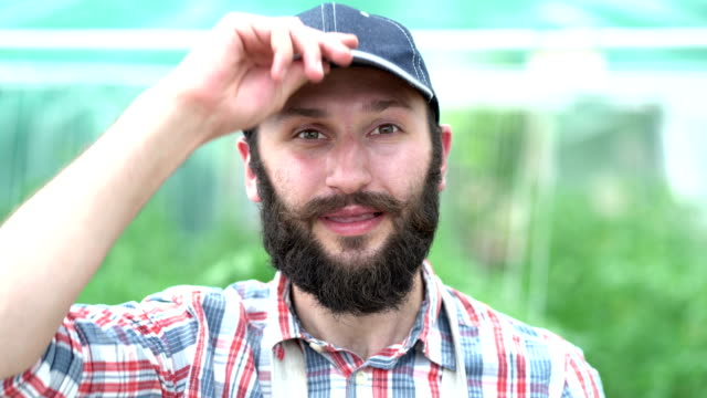 smiling farmer in greenhouse - environmentalist stock videos & royalty-free footage