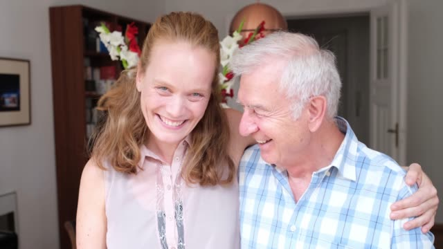 smiling father and daughter together at home - adult offspring stock videos & royalty-free footage