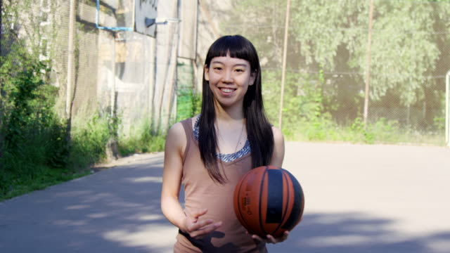 smiling female basketball player standing on court - bangs stock videos & royalty-free footage