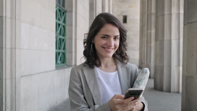 smiling female caucasian law student at entrance to school - neo classical stock videos & royalty-free footage