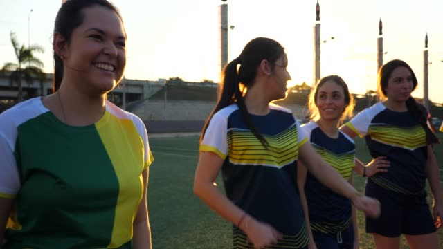 pan smiling female soccer players from opposing teams in discussion after soccer match - transparent stock videos & royalty-free footage