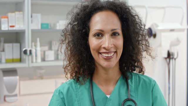 smiling female veterinarian in her office - animal hospital stock videos & royalty-free footage