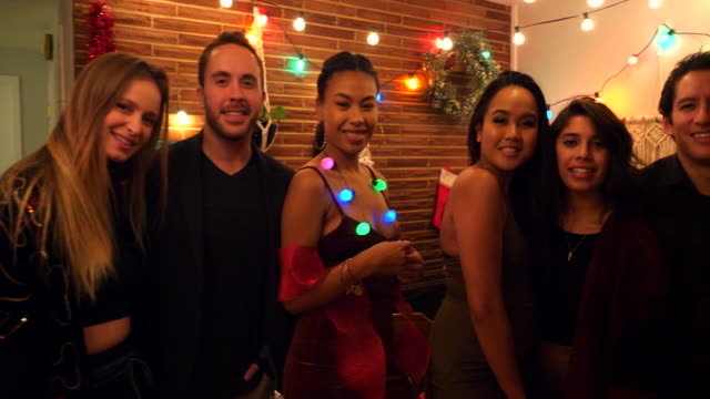 pan smiling friends posing for group photo during holiday party in home - pacific islander portrait stock videos & royalty-free footage
