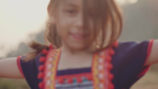 smiling girl looking up the sky and twirling - windswept stock videos & royalty-free footage