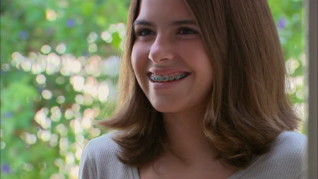 cu, smiling girl (10-11) outdoors, los angeles, california, usa - brace stock videos and b-roll footage