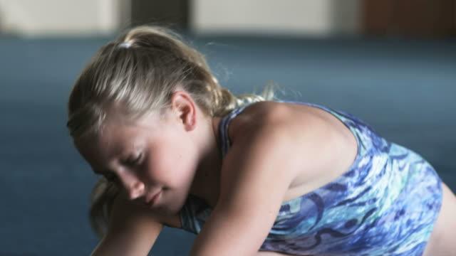 cu smiling girl (10-11) stretching in gym, orem, utah, usa - orem utah stock videos & royalty-free footage