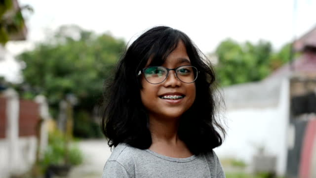 smiling girl - indonesia video stock e b–roll