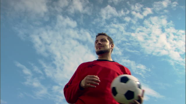 Smiling goalie with soccer ball