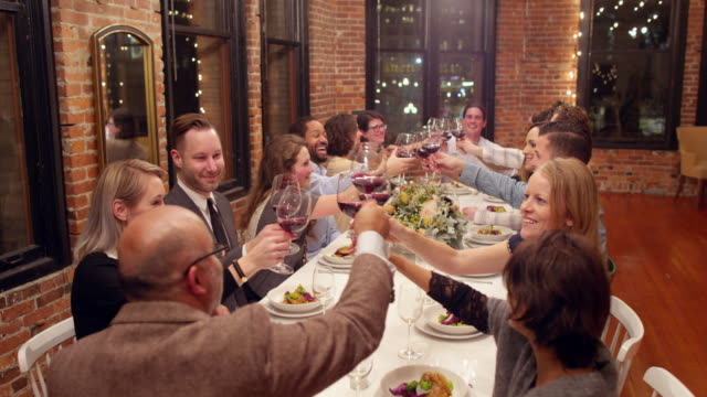 ms smiling group of friends toasting wine glasses during dinner party - dinner party stock videos & royalty-free footage
