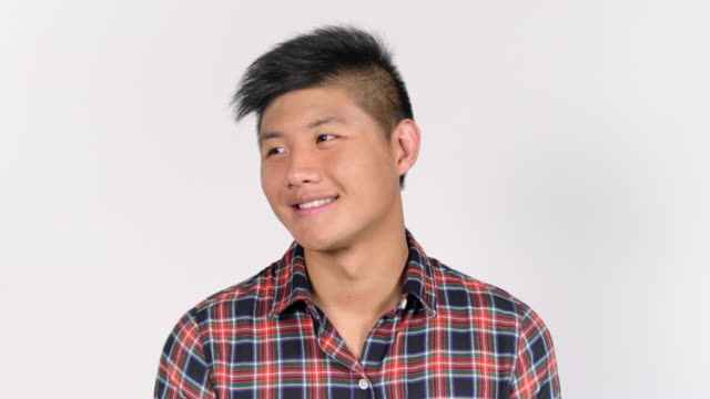 smiling handsome young man in plaid shirt - plaid shirt stock videos & royalty-free footage
