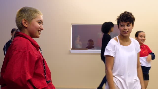 ms smiling hip hop students in discussion while taking a break during dance class - dance studio stock videos & royalty-free footage