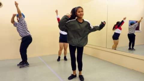 ms smiling hip hop students practicing dance routine in dance studio - dance studio stock videos & royalty-free footage
