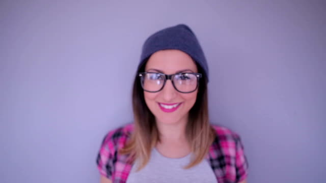 smiling hipster girl - woolly hat stock videos & royalty-free footage