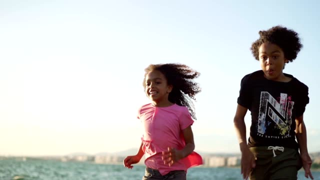 smiling kids running - brother stock videos & royalty-free footage