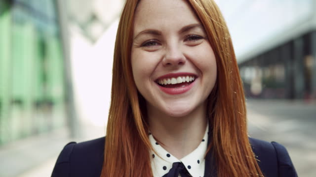 smiling, laughing, happy woman looking at camera - redhead stock videos & royalty-free footage