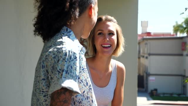 vídeos y material grabado en eventos de stock de ms smiling lesbian couple in discussion on hotel room balcony - pareja de mediana edad