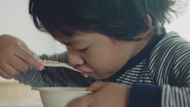 smiling little boy eating close - breakfast cereal stock videos & royalty-free footage