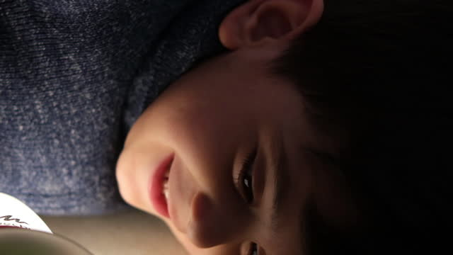 smiling little boy hiding under blanket - duvet stock videos & royalty-free footage