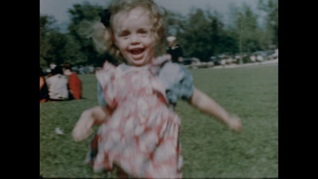 1947 smiling little girl run in a sunny park - carefree stock videos & royalty-free footage
